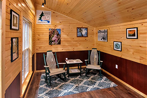 Custom Home Office Building from Pine Creek Structures | Finished Shed Interior with knotty pine walls, LP wainscot, electrical package, and custom upgrades