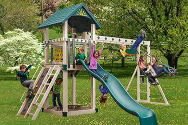 The Cubby's Fort Vinyl Play Set with kids playing and swinging and climbing