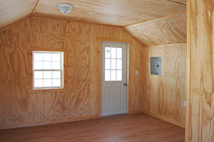 Custom Home Office Building from Pine Creek Structures | Finished Shed Interior with unpainted beadboard walls and ceiling, electrical package, and custom upgrades