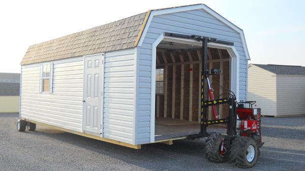 Portable Garage being moved with the Shed Mule