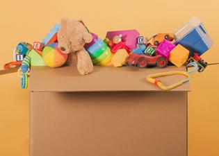 box of baby and toddler toys