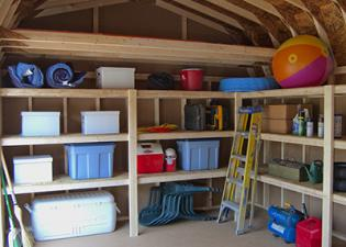 Storing a items in a shed with a loft and shelves