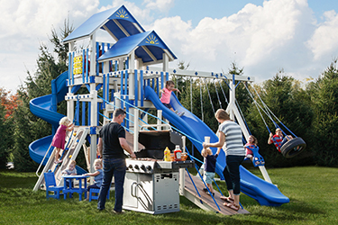The Galaxy Vinyl Play Set with kids playing and swinging and parents