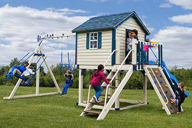 The Sailor's Retreat Vinyl Play Set with children swinging and playing together