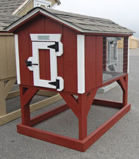Red and White rabbit hutch back animal shelter constructed by Pine Creek Structures
