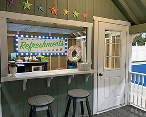 Cape Cod Style Poolside Snack Shed with bar window built by Pine Creek Structures