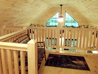 second floor bedroom in custom chalet cabin