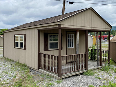 white deer peak cabin with porch, railing, and unfinished interior in connellsville, pa