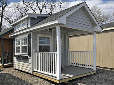 custom cape cod style building with cape dormer, porch, and interior finish from pine creek structures