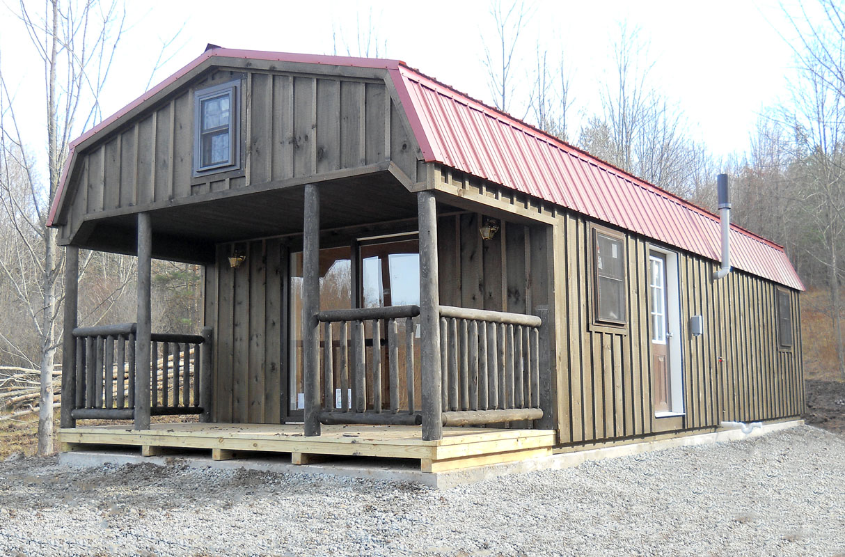 Custom Board 'N' Batten Dutch Cabin with porch, sliding doors, loft ...
