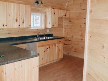 Custom Board 'N' Batten Dutch Cabin with porch, sliding doors, loft, and finished interior