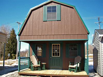 two-story recreational cabin with porch, second floor, and unfinished interior in kersey, pa