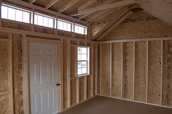 View inside a Vinyl Cape Cod Storage Shed with new cape dormer upgrade (Pine Creek Structures)