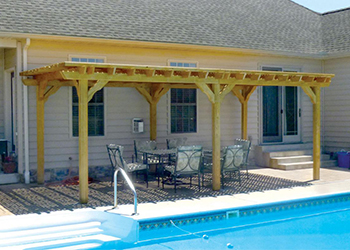 12' x 22' Traditional style wood pergola shown with bee's wax stain and lattice top