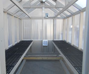 inside of 8x12 large prefabricated greenhouse from pine creek structures