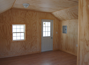 Custom Vinyl Cape Cod Style Home Office Building with Finished Interior built by Pine Creek Structures
