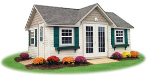 deluxe style victorian ready made storage shed with lp smart side siding and custom features including flower boxes, french doors, and scalloped siding in gables