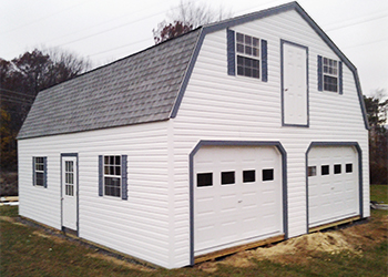Custom two car two story garage built by Pine Creek Structures