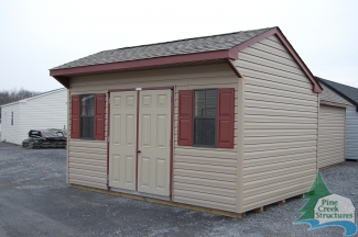 10x14 Clay Vinyl Cottage with Red Trim and Shutters