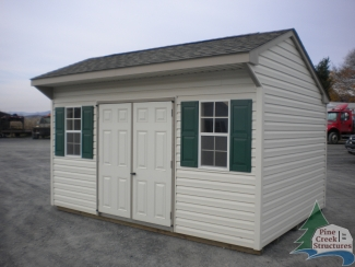 10x14 Vinyl Cottage Storage Shed with clay trim and green shutters
