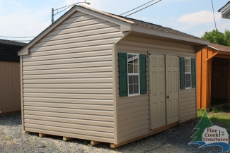 10x14 Vinyl Cottage with Clay walls, Clay trim, and Weatherwood shingles
