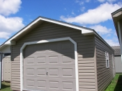 Moore Country Pine Creek 14x28 Clay Vinyl Peak Style Garage with White Trim