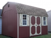 Moore Country Pine Creek 10x14 Red Dutch Barn With Beige Trim.
