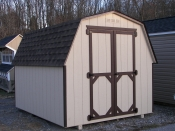 Moore Country Pine Creek 8x10 Tan Madison Mini Barn with Dark Brown Trim