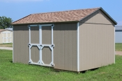 Madison Peak Shed with buckskin walls, white trim and shakewood shingles