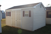 10X14 Peak Style Shed with Sandel wood walls, White trim, and Shakewood shingles