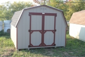 10X14 Madison Mini Barn Shed with Buckskin walls, Red trim, and Charcoal shingle