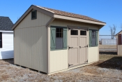 10X14 Cottage with beige walls buckskin trim avacado shutters and shakewood roof
