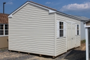 12x16 Peak Shed with Classic Sand walls, White trim, and Shakewood shingles