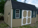 Pine Creek 10x14 Cambrel Dutch Shed with white trim and green shutters