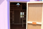 8x10 Club House Play with Pink walls, Purple/White trim, and Charcoal shingles