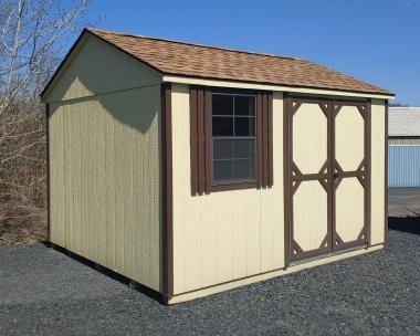 10x12 Peak Shed Exterior with beige siding and dark brown trim