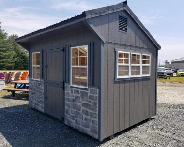 Pine Creek 10x14 HD Cottage with Light Grey walls, White trim, Blue shutters, and Charcoal shingles