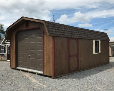 10x12 Vinyl Peak Style Shed with Harborstone walls, White trim, Black shutters, and Oyster Grey shingles